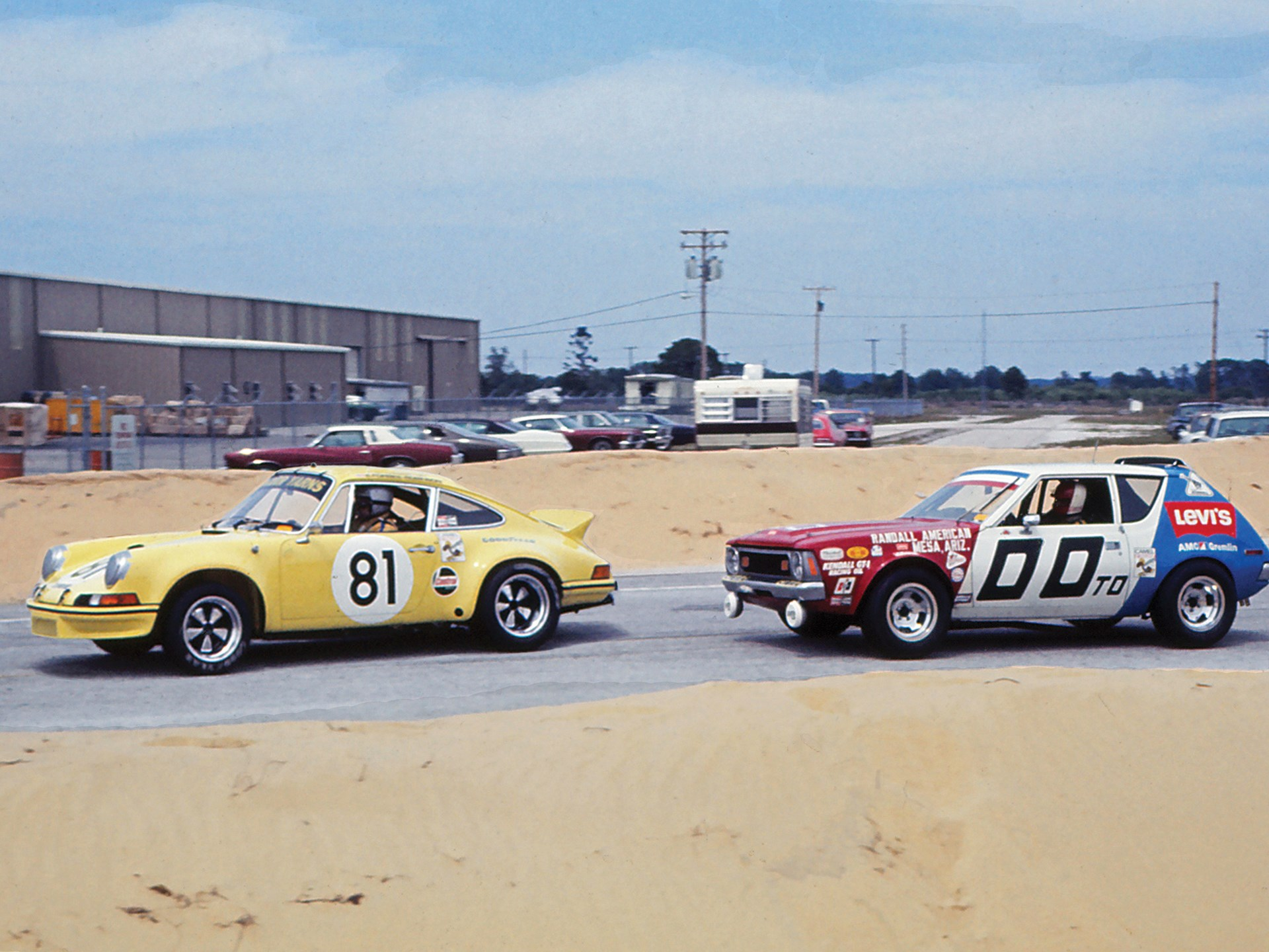 The 2.8 RSR racing past an AMC Gremlin at the 1973 12 Hours of Sebring.