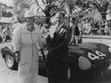 1955 Jaguar D-Type  - $Bib Stillwell poses with XKD 520 during the Lowood Tourist Trophy in 1956.