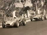 1961 Scarab Formula Libre  - $Chuck Daigh, in the #5 Scarab, leads the #7 Lotus of Stirling Moss at the 1962 Sandown International Cup, Melbourne, Australia.