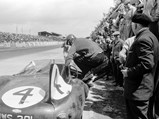 1955 Jaguar D-Type  - $Ninian Sanderson jumps into XKD 501 en route to an overall win at the 24 Hours of Le Mans.