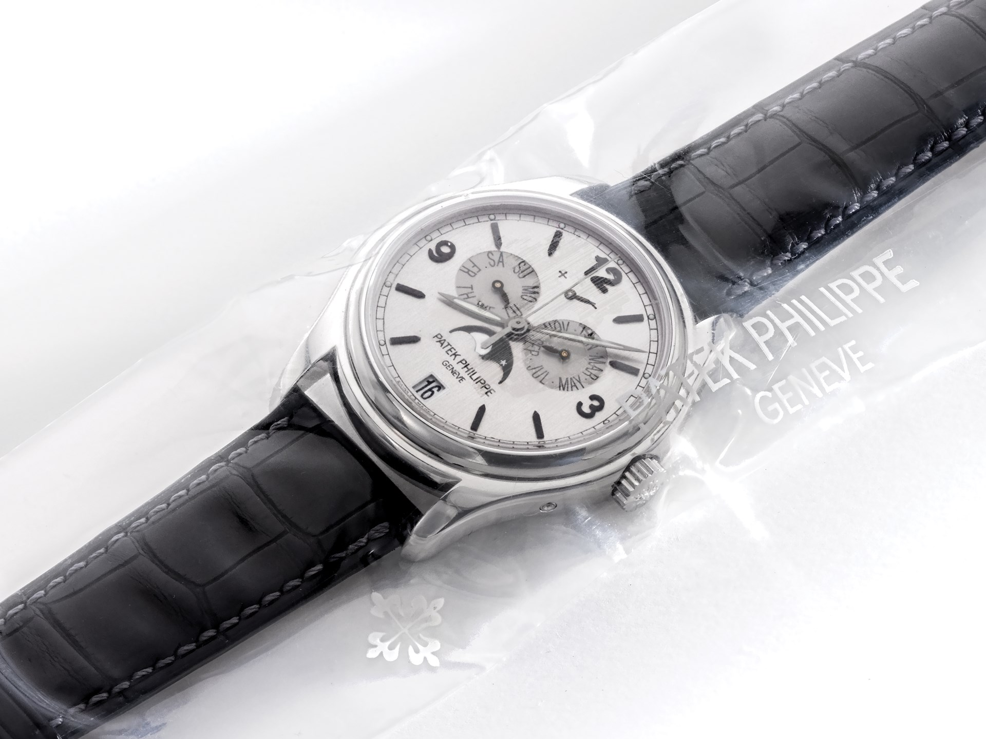 Patek Philippe, Fine White Gold Automatic Calendar Wristwatch with Moon Phases and Power Reserve Indication