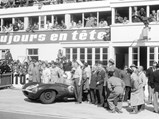 1955 Jaguar D-Type  - $Chassis no. 501 poses with its drivers and other members of the Ecurie Ecosse team after winning the 1956 24 Hours of Le Mans.