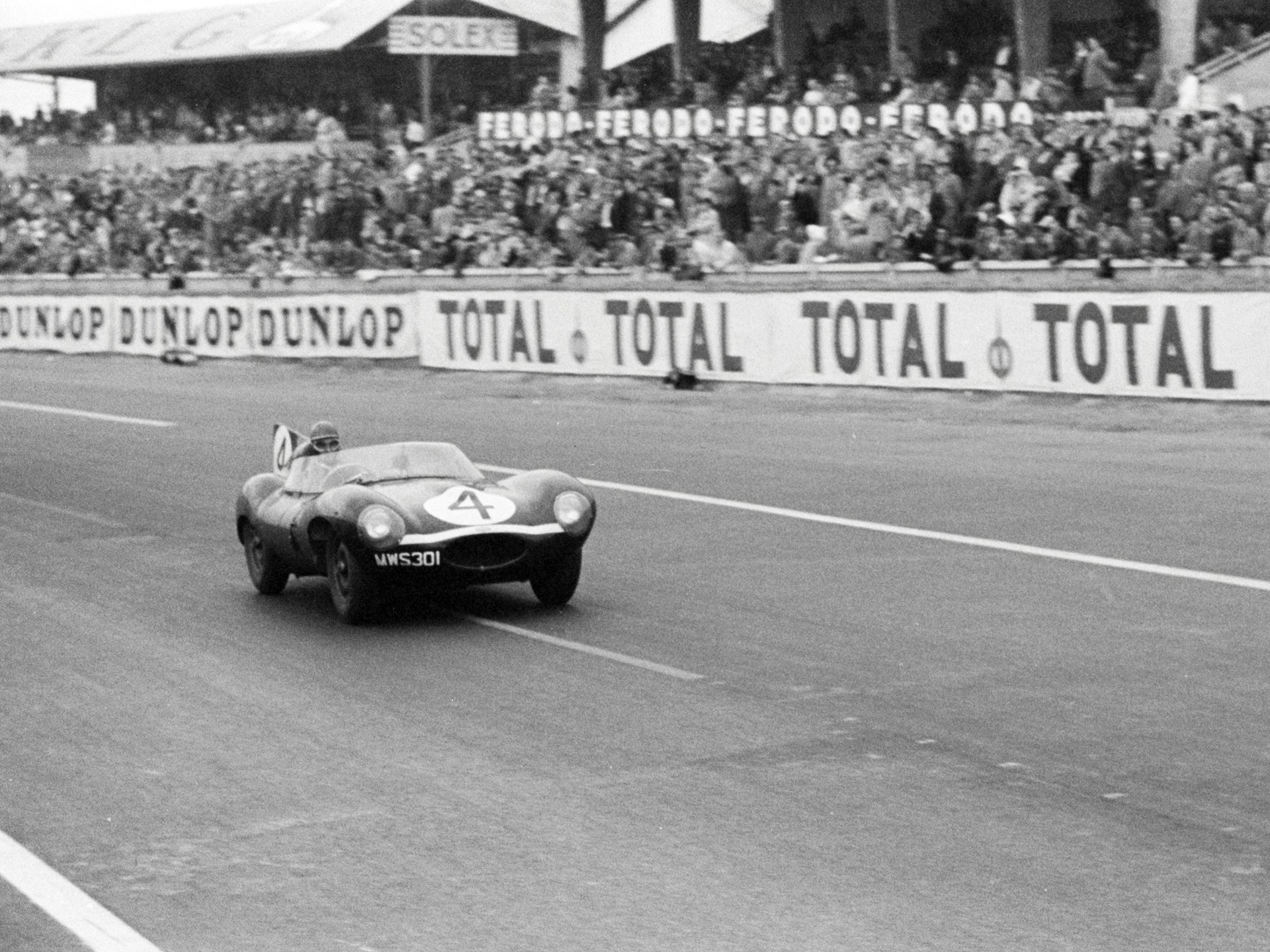 Chassis no. XKD 501 passing the grandstands en route to a first place finish at the 1956 24 Hours of Le Mans.