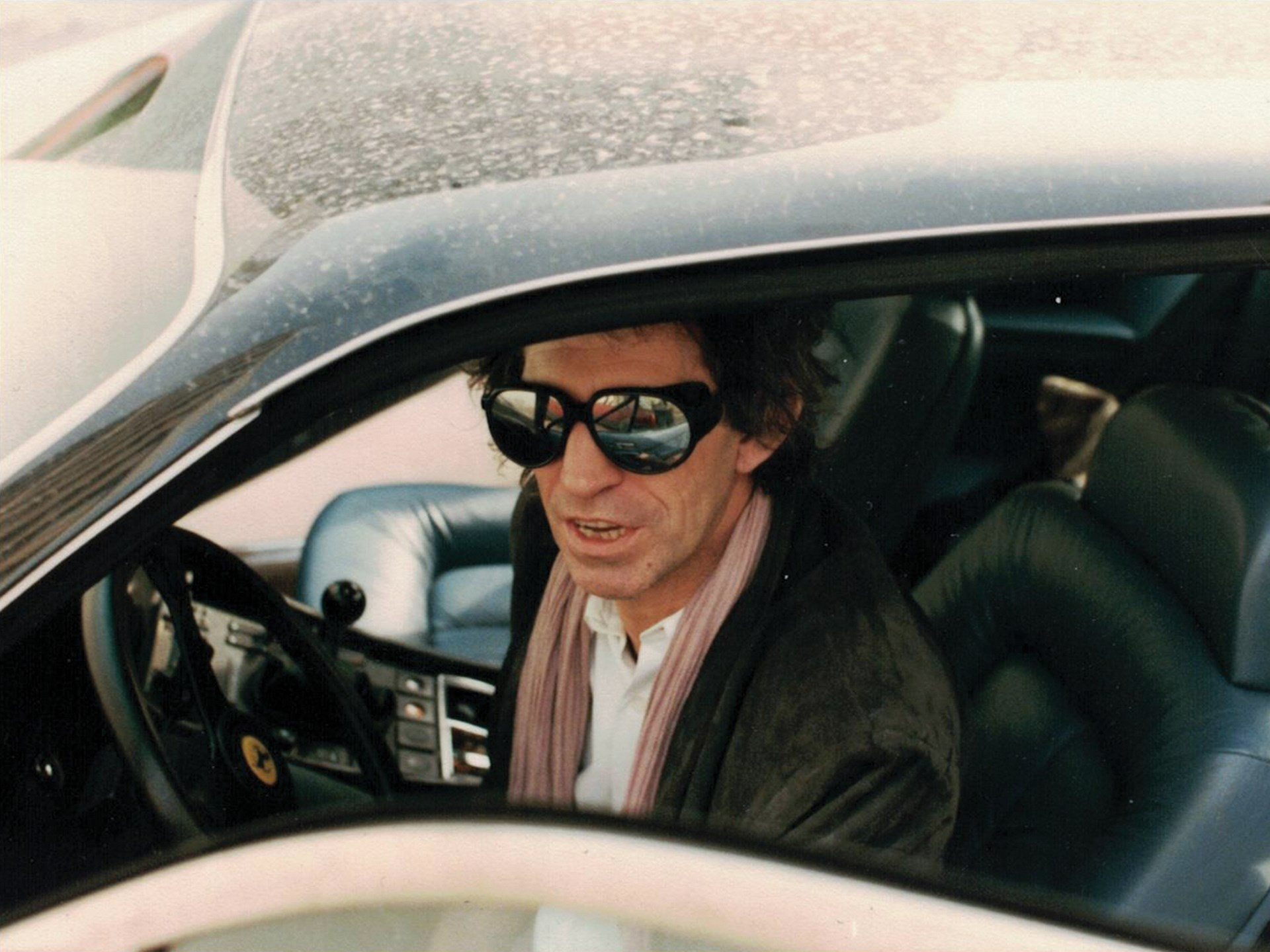 Keith Richards at the wheel of his new Ferrari 400i, which he received directly from the factory in the early 1980s.