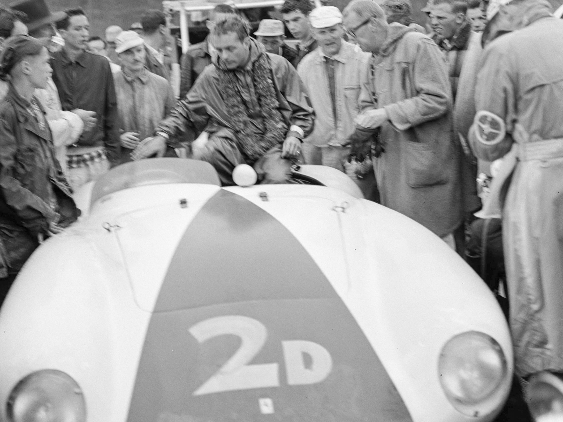 Phil Hill celebrates his success atop the 750 Monza following his win at the Del Monte Trophy Race at Pebble Beach in 1955.