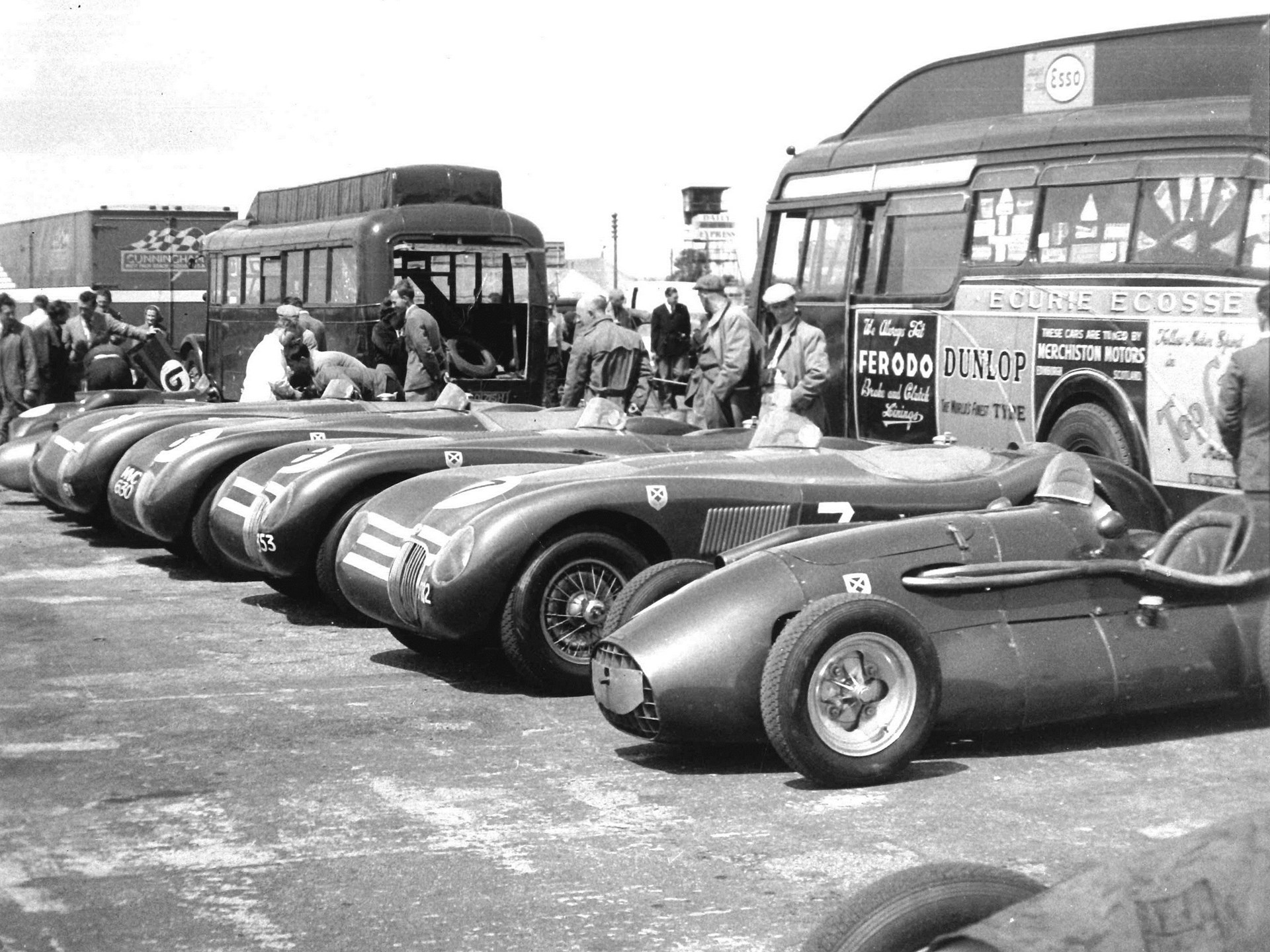 The Connaught alongside the rest of the Ecurie Ecosse team at the British GP Meeting in 1953.