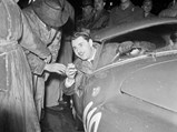"""1950 Ferrari 166 MM/212 Export """"Uovo"""" by Fontana - $Gianni Marzotto interacts with the crowd at the start prior to the 1951 Mille Miglia."""