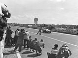 1955 Jaguar D-Type  - $XKD 501 takes the checkered flag at the 1956 24 Hours of Le Mans.