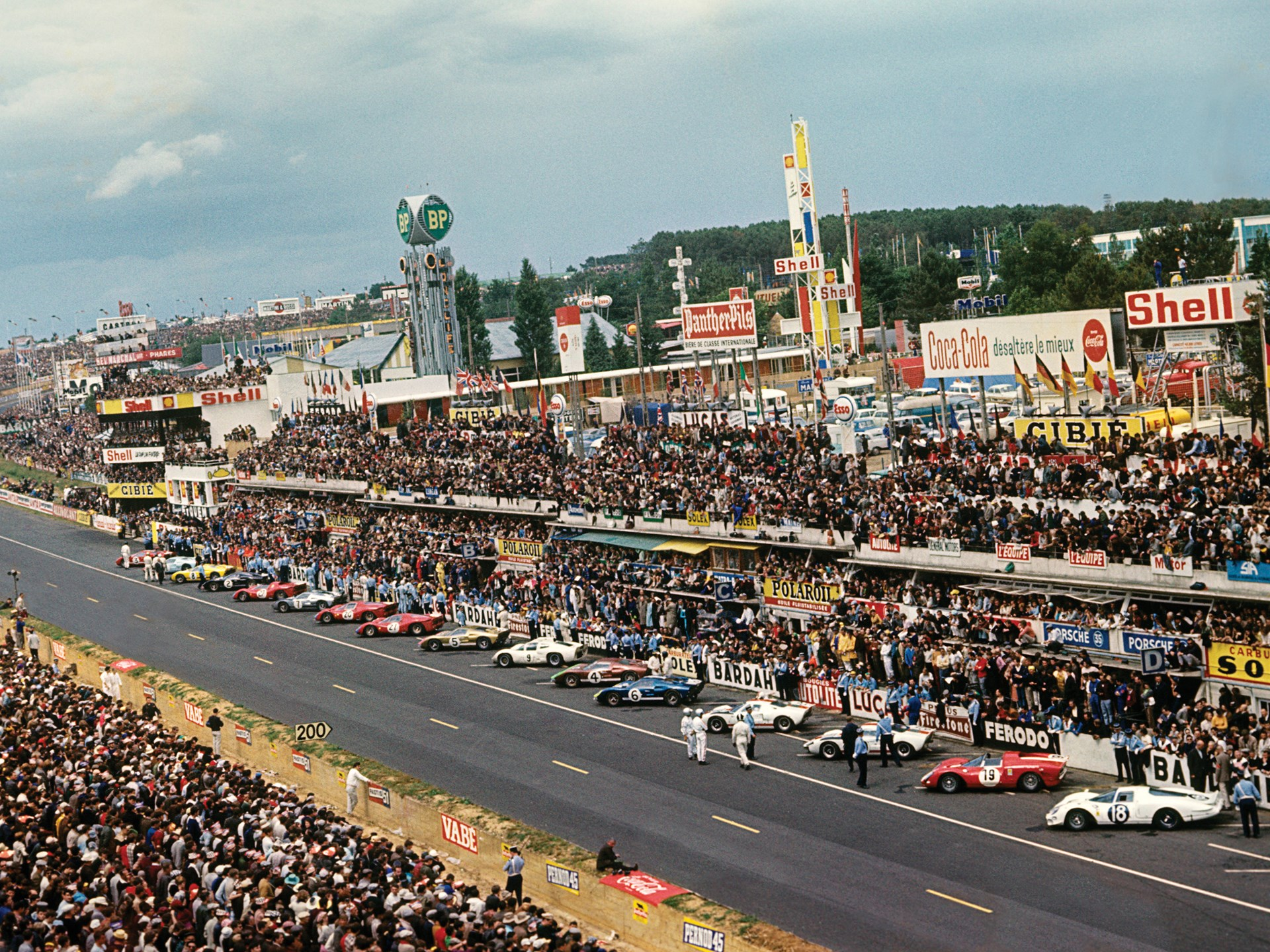 All lined up and ready to go, P/1016 stands out in its Kandy Gold livery at Le Mans in 1966.