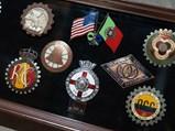 Assortment of Framed Club Badges - $