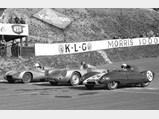 1957 Porsche 550A Spyder by Wendler - $Julius Voigt-Nielsen fights Gordon Jones and his Lotus 11 for the lead at Roskilde, Denmark in April of 1957.