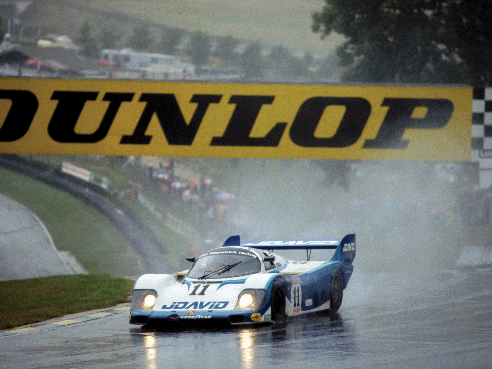 Chassis no. 956-110 races to a first place finish at Brands Hatch in 1983.
