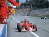 2002 Ferrari F2002  - $Michael Schumacher, pictured in the Ferrari F2002, raises his fist in victory at the 2002 San Marino Grand Prix.