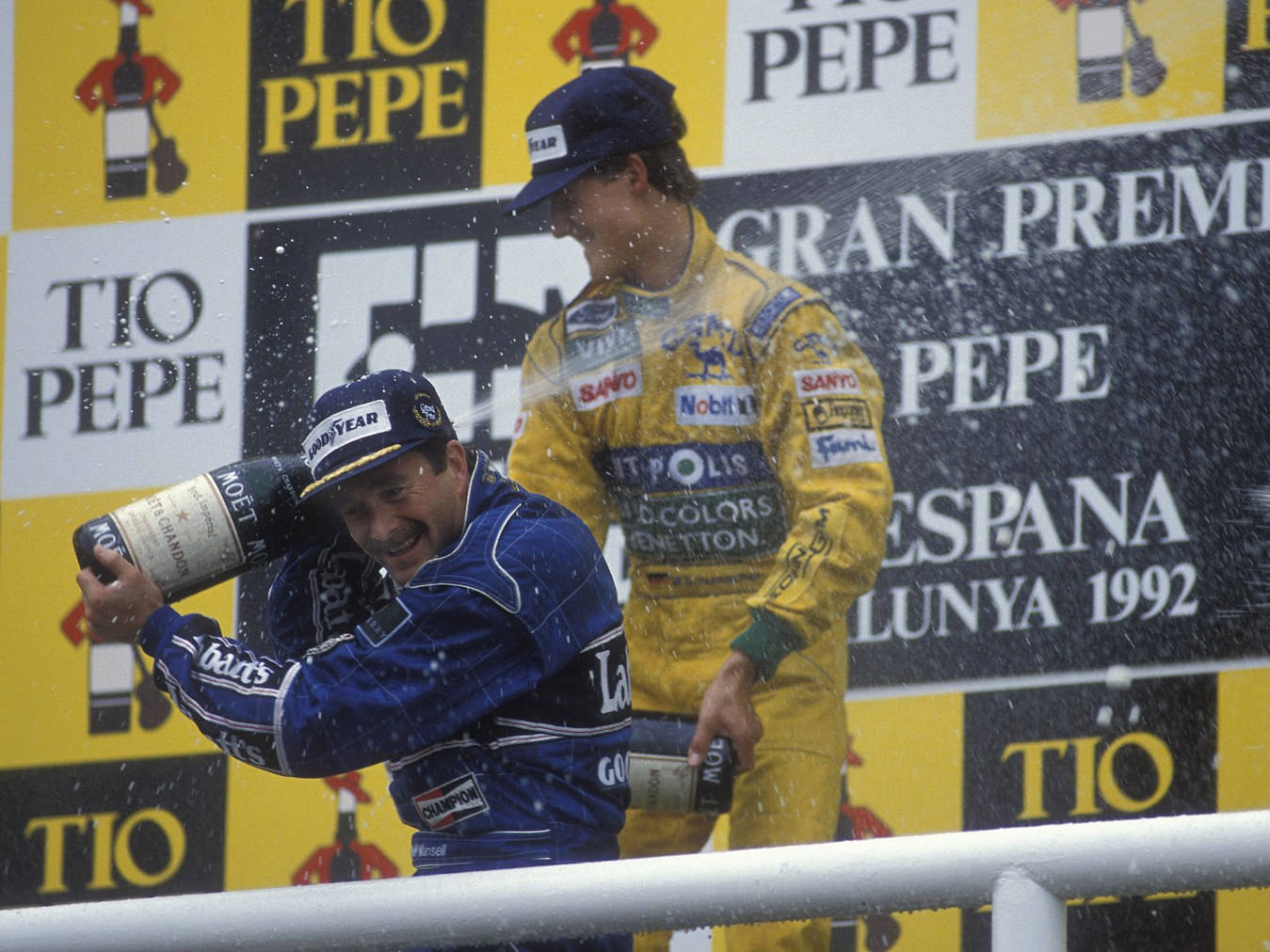 Michael Schumacher and Nigel Mansell celebrate atop the podium after the 1992 Spanish Grand Prix.
