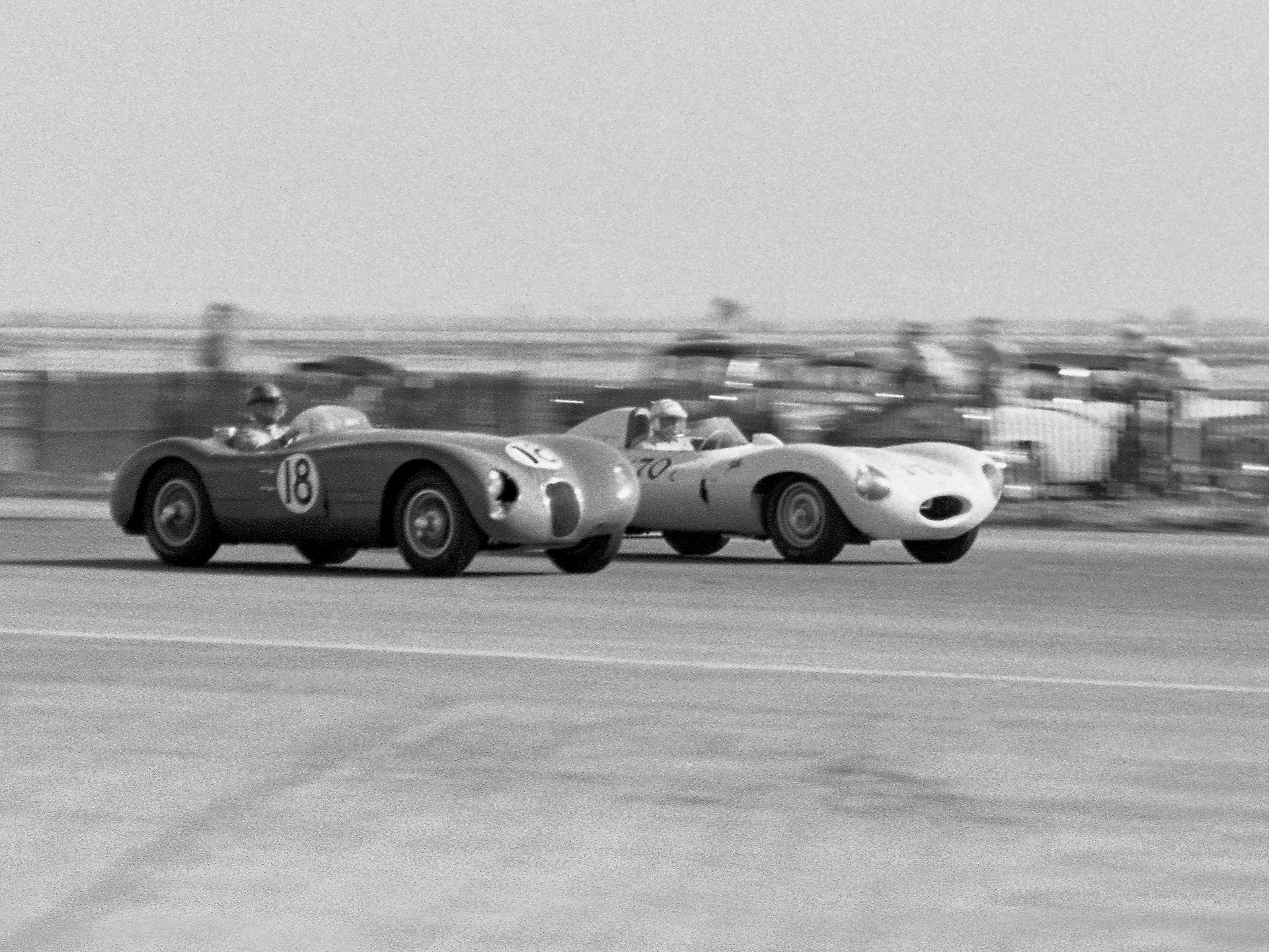 XKC 007 and Carlyle Blackwell go nose-to-nose with Pete Woods and his D-Type at Santa Barbara.