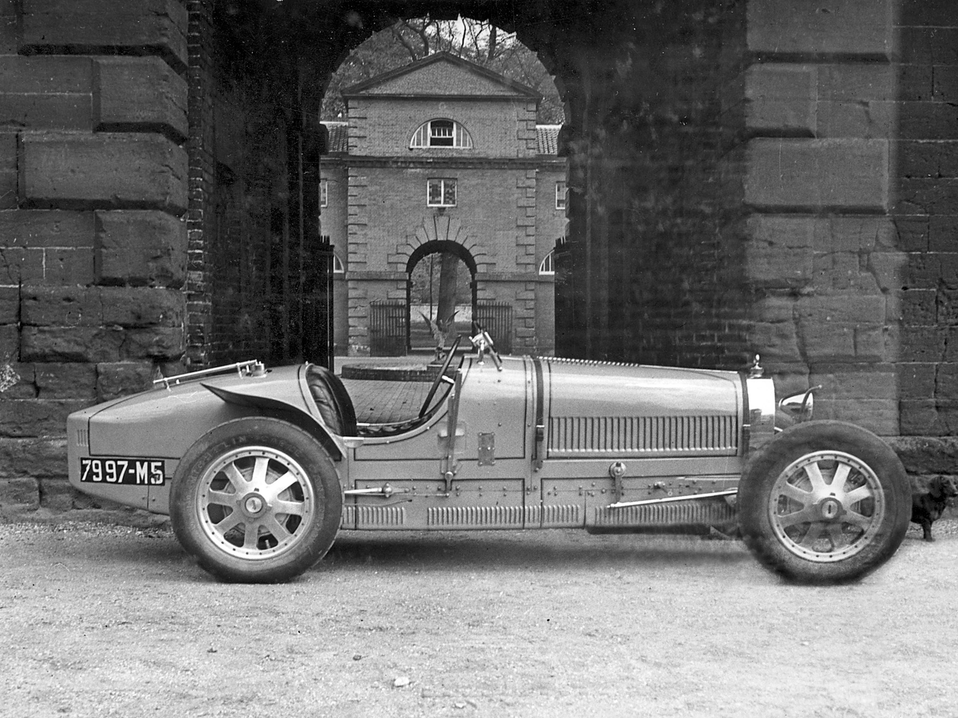 The Bugatti pictured outside of the stables at Houghton Hall, Lord Cholmondeley's ancestral home, during his ownership.