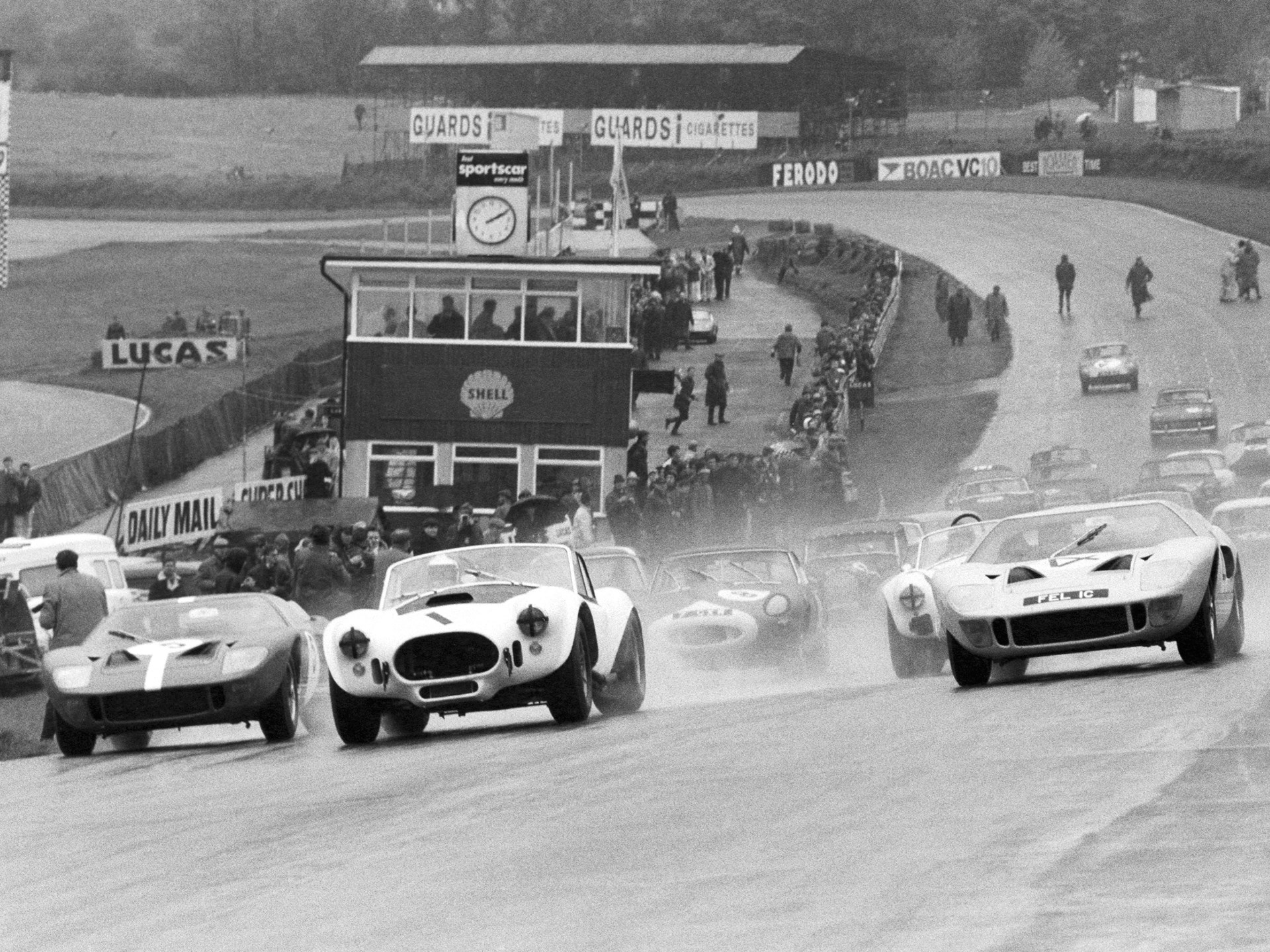 The team of Bob Bondurant and David Piper lead the way at Brands Hatch, 1966.