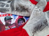 Michael Schumacher Race Worn and Signed Gloves - $