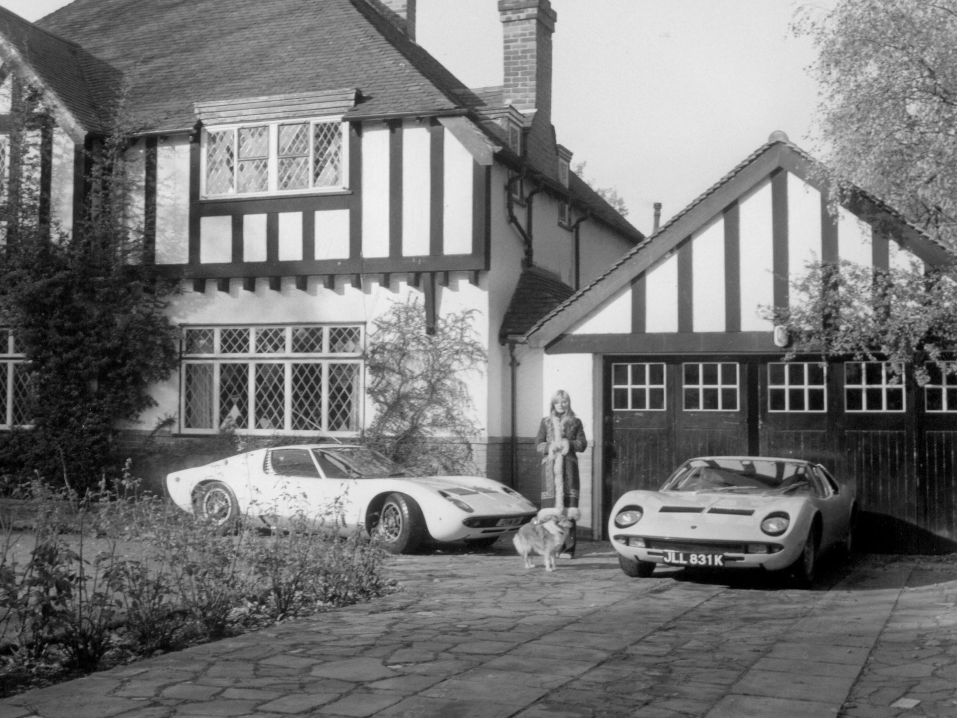 Rod Stewart's girlfriend poses with his Lamborghini Miuras outside his home in Southgate circa 1971-1972.