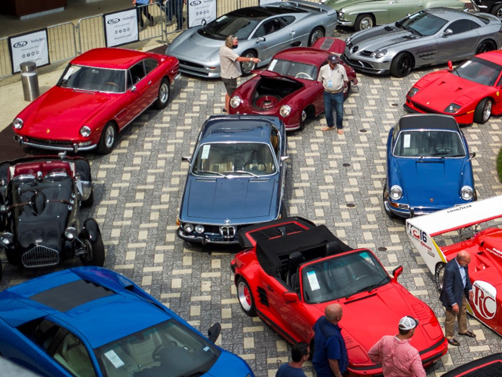 Spectators viewing lots on display at RM Sothebys Live Monterey Auction Preview 2021