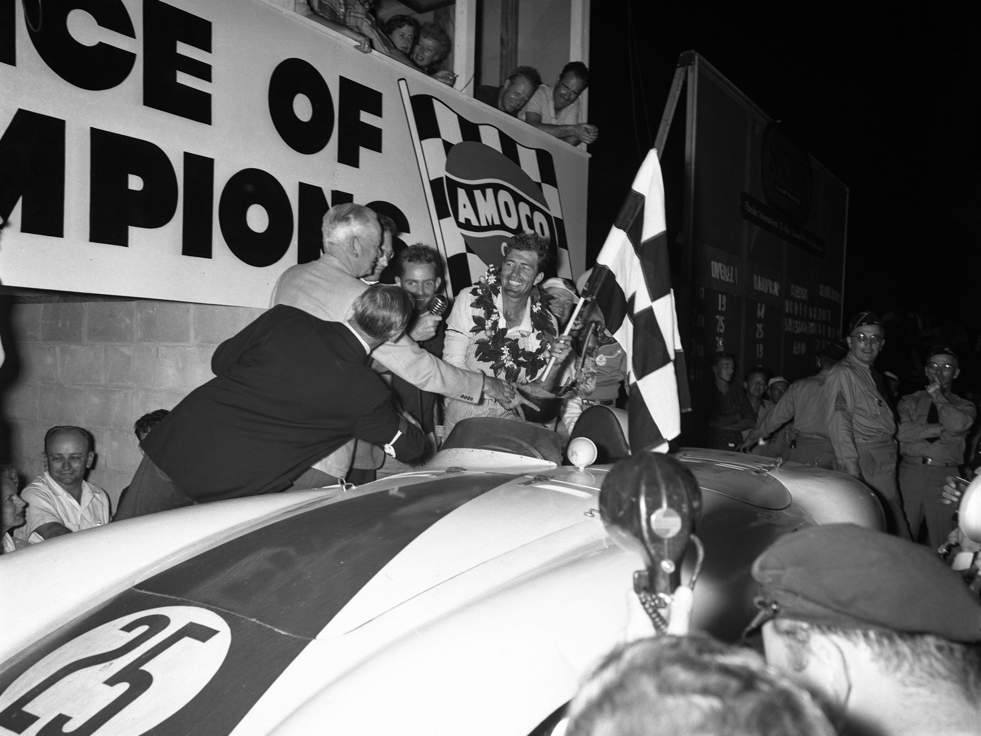 Carroll Shelby and Phil Hill celebrate their perceived victory in the 1955 12 Hours of Sebring before their result was overturned, leaving them in second place overall.