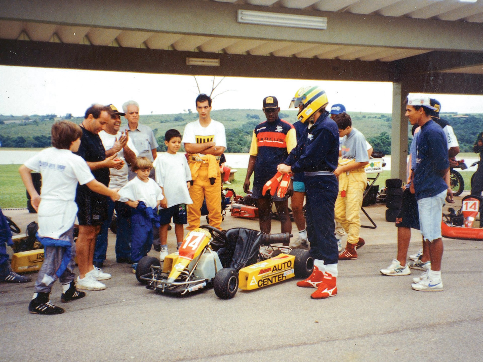 Senna and friends pictured shortly before his drive with the kart in March of 1994.