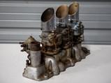Cyclone Intake Manifold with Three Stromberg Carburetors - $