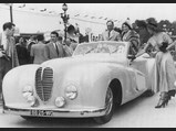 1948 Delahaye 135 M Cabriolet 'Malmaison' by Pourtout - $Pictured at a concours d'elegance event in Enghien-Les-Bains, France, in 1949. Among the occupants seated in the car are Jeanne Sourza, the French actress, while the coachbuilder Jacques Saoutchik is seen underneath the loudspeaker.