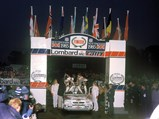 1985 Lancia Delta S4 Rally  - $Henri Toivonen and Neil Wilson celebrate their victory after the 1985 Lombard RAC Rally.
