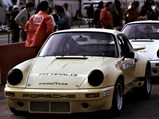1974 Porsche 911 Carrera RSR 3.0 IROC  - $Having just secured pole position for the inaugural IROC race at Riverside, the Sahara Beige chassis of Emerson Fittipaldi waits in pit lane for the application of its #1 race livery by IROC staff.