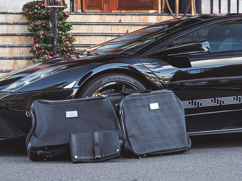 2008 Lamborghini Murciélago LP6404 Coupé Versace EGear and matching luggage set offered at RM Sothebys Paris Auction 2021