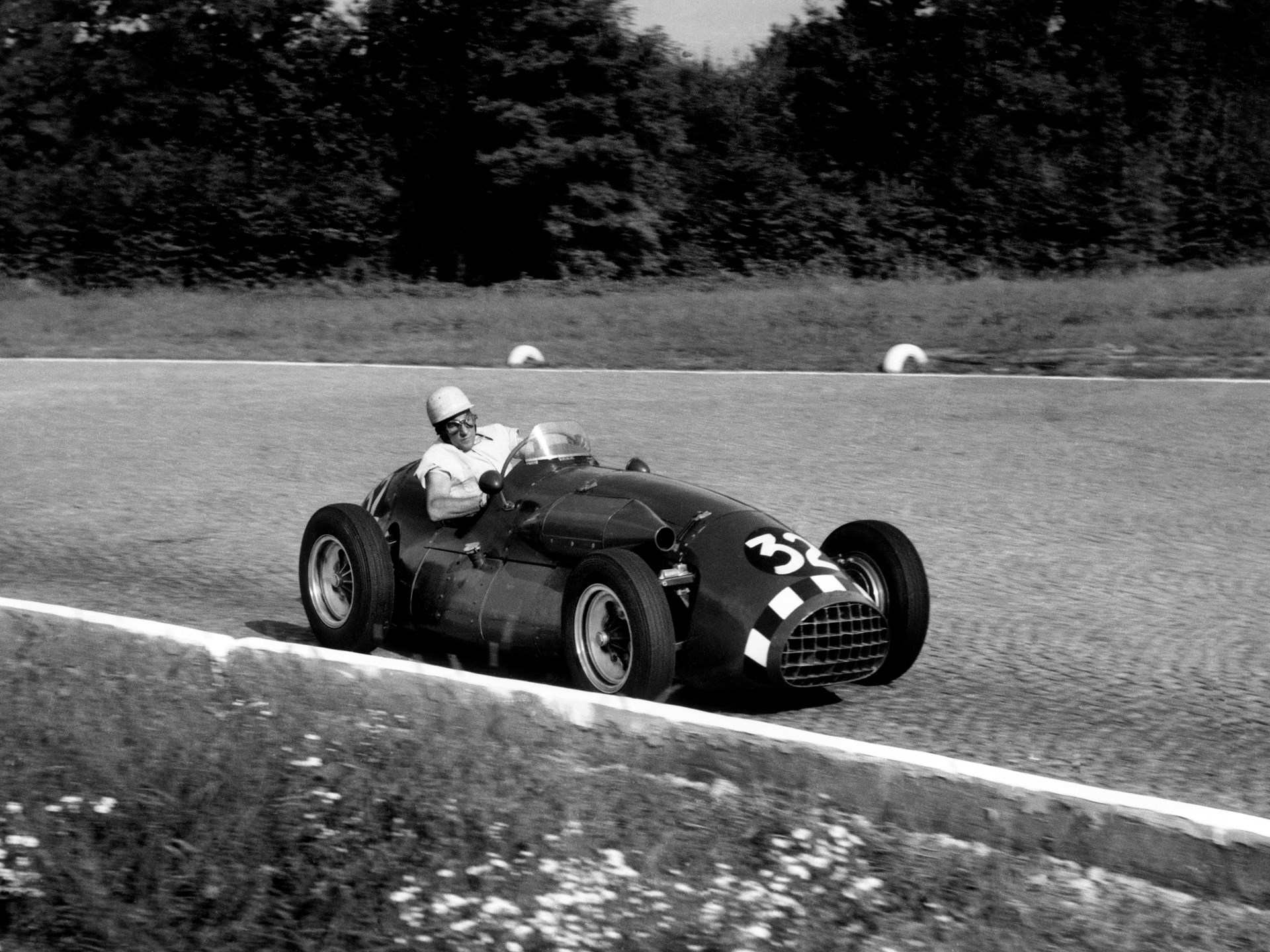 Stirling Moss behind the wheel of the Connaught at the 1952 Italian Grand Prix at Monza.