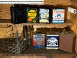 Pair of 8-Pack Motor Oil Racks and Assorted Oil Cans - $