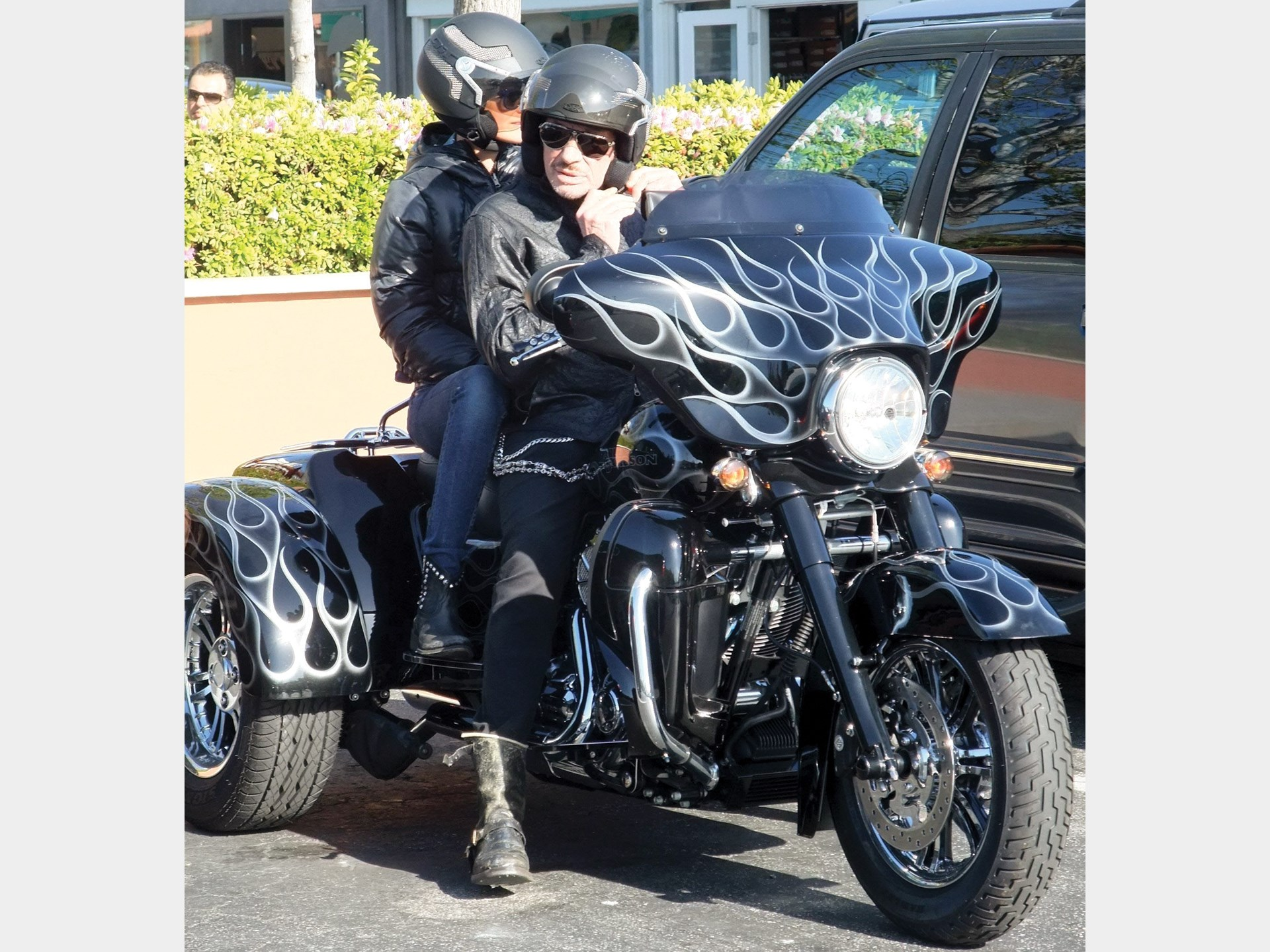 Johnny Hallyday and his wife Laeticia on their Harley-Davidson in Malibu, California in 2011.