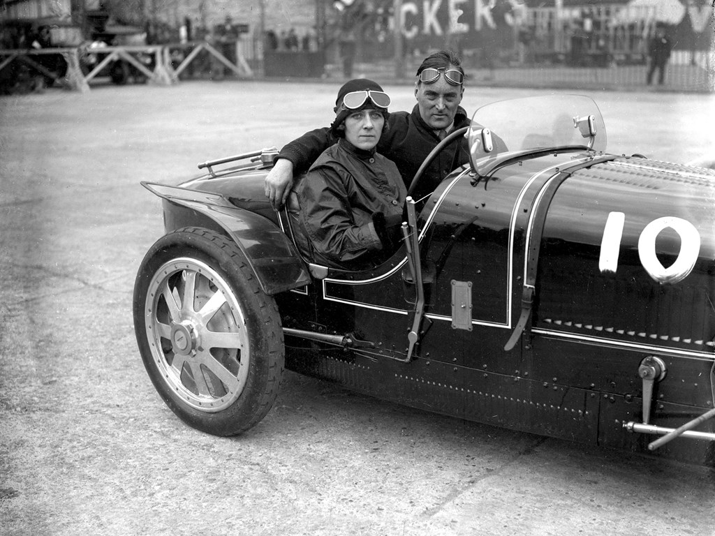 Lady Cholmondeley and Malcolm Campbell pose for a photo in chassis number 4394 at Brooklands.