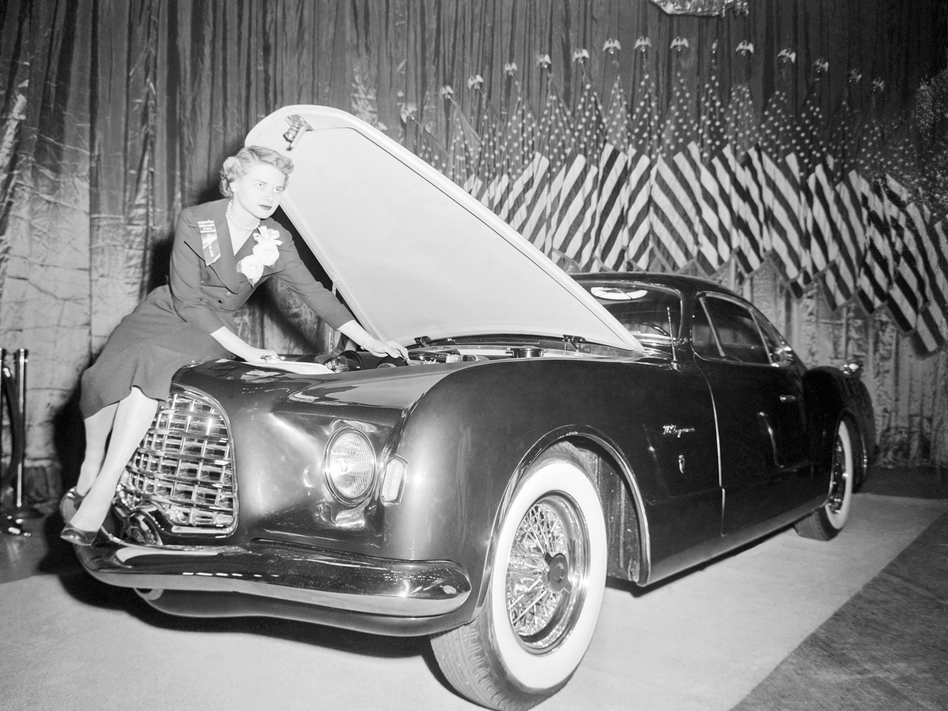 Chrysler engineer Lucille Pieti makes last minute adjustments on the new Chrysler D'Elegance at the Easter Parade of Stars at the Waldorf-Astoria in New York.