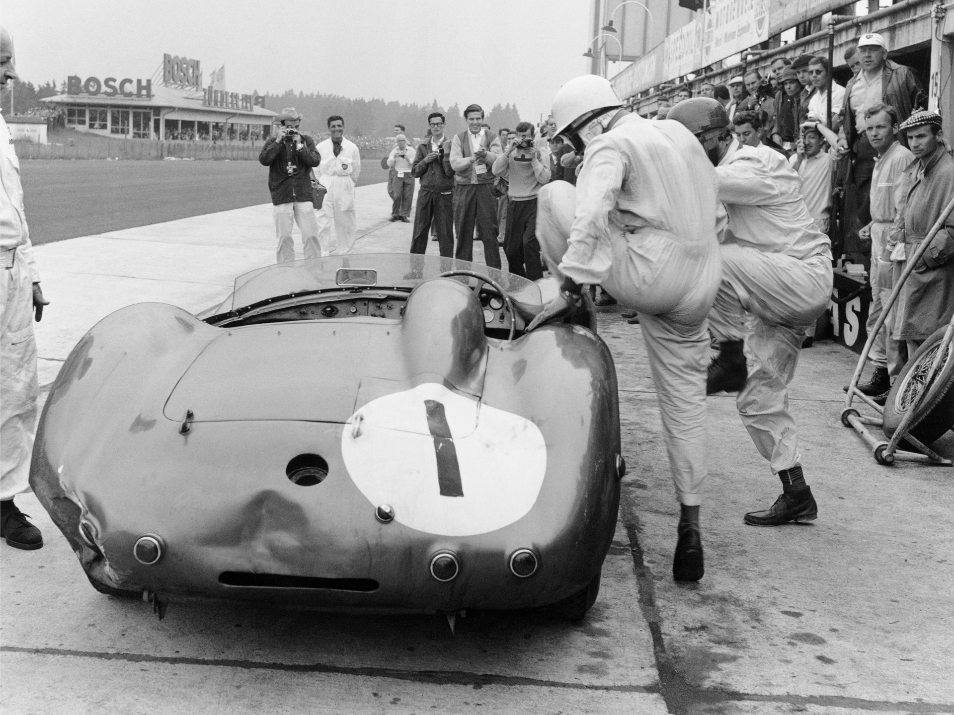 Nurburgring, Germany. 1st June 1958. Stirling Moss / Jack Brabham (Aston Martin DBR1), 1st position, pit stop and driver change, action. World Copyright: LAT Photographic. Ref: 4235.