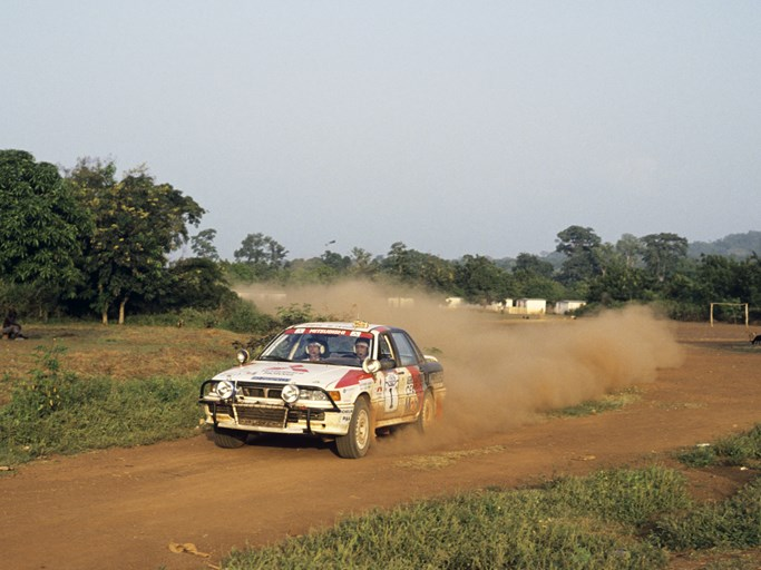 Patrick Tauziac and Claude Papin at speed during the 1990 Rallye Côte d'Ivoire Bandama.