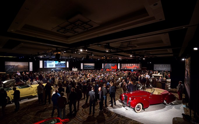 1. A packed auction room as the top-selling Mercedes-Benz 540 K crosses the auction block.jpg
