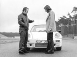 1974 Porsche 911 Carrera RS 3.0  - $Jürgen Barth (right) and a journalist from Autosport discuss the performance of this Carrera RS during the press release, Hockenheimring, 1973.