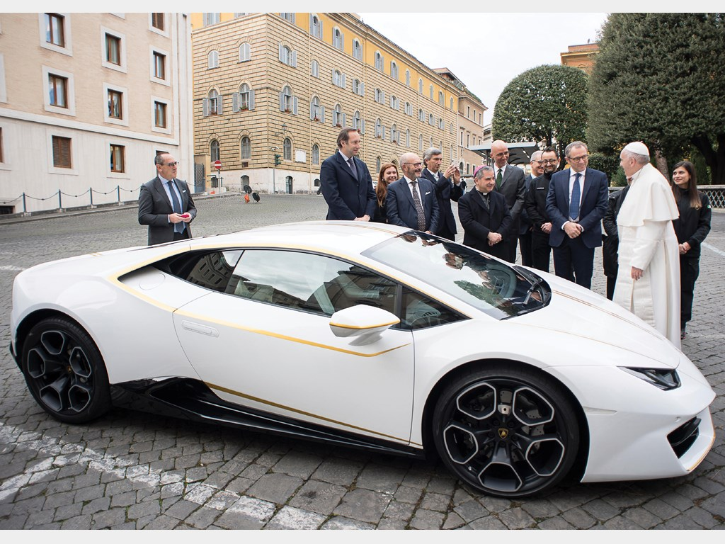 His Holiness Pope Francis signs the Lamborghini Huracán at a ceremony in Vatican City in November of 2017.