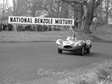 1955 Jaguar D-Type  - $The #55 D-Type powers up the hill and past the crowds at the British Empire Trophy Meeting, Oulton Park, 6 April 1957.