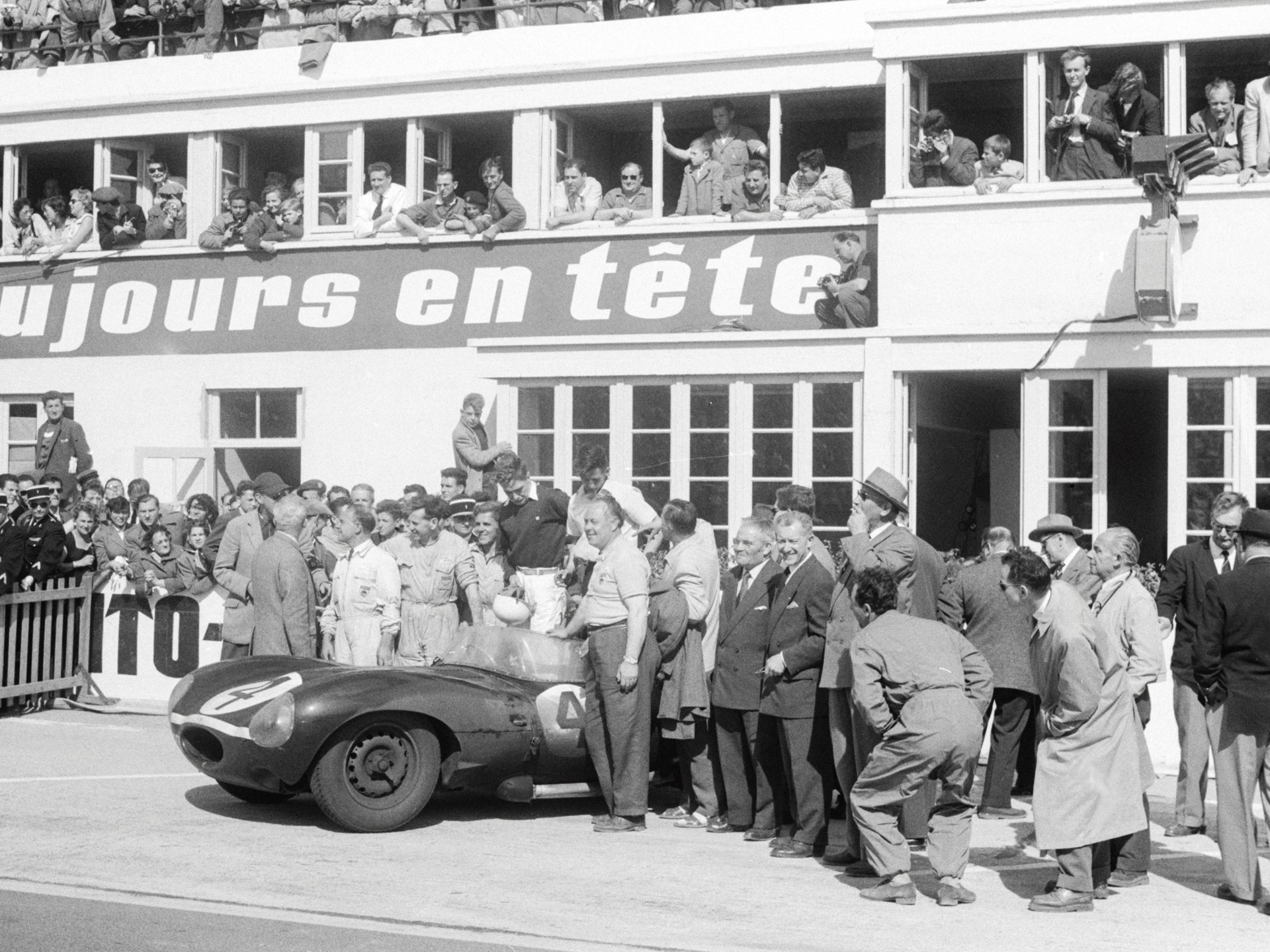 Chassis no. 501 poses with its drivers and other members of the Ecurie Ecosse team after winning the 1956 24 Hours of Le Mans.
