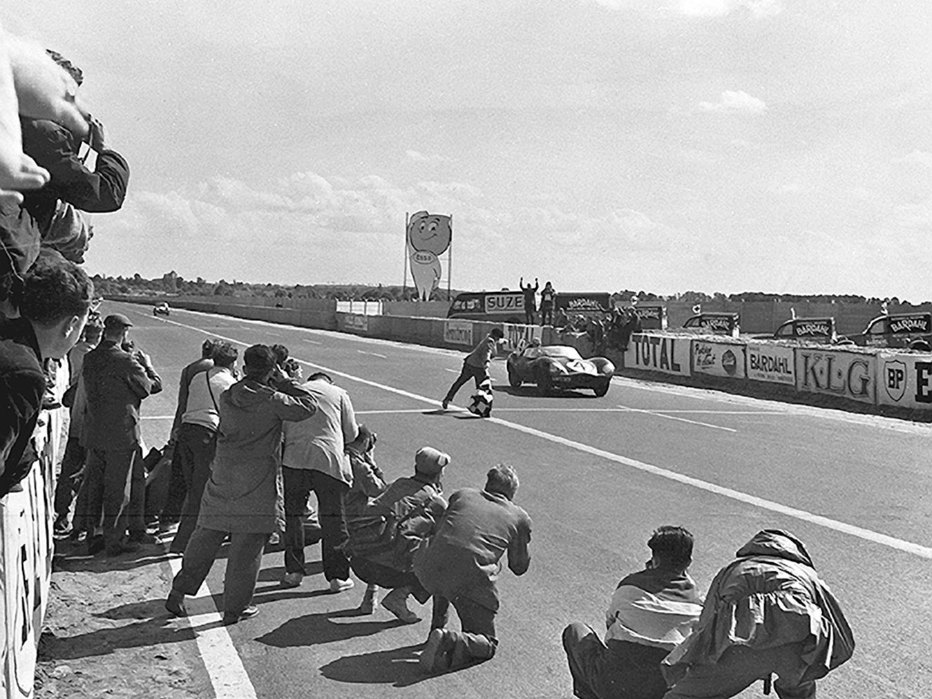 XKD 501 takes the checkered flag at the 1956 24 Hours of Le Mans.