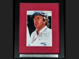 Jackie Stewart Signed Photograph - $