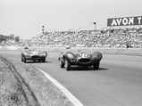 1954 Jaguar D-Type Works  - $Bob Berry behind the wheel of OKV2 at the 1957 British Grand Prix at Aintree.