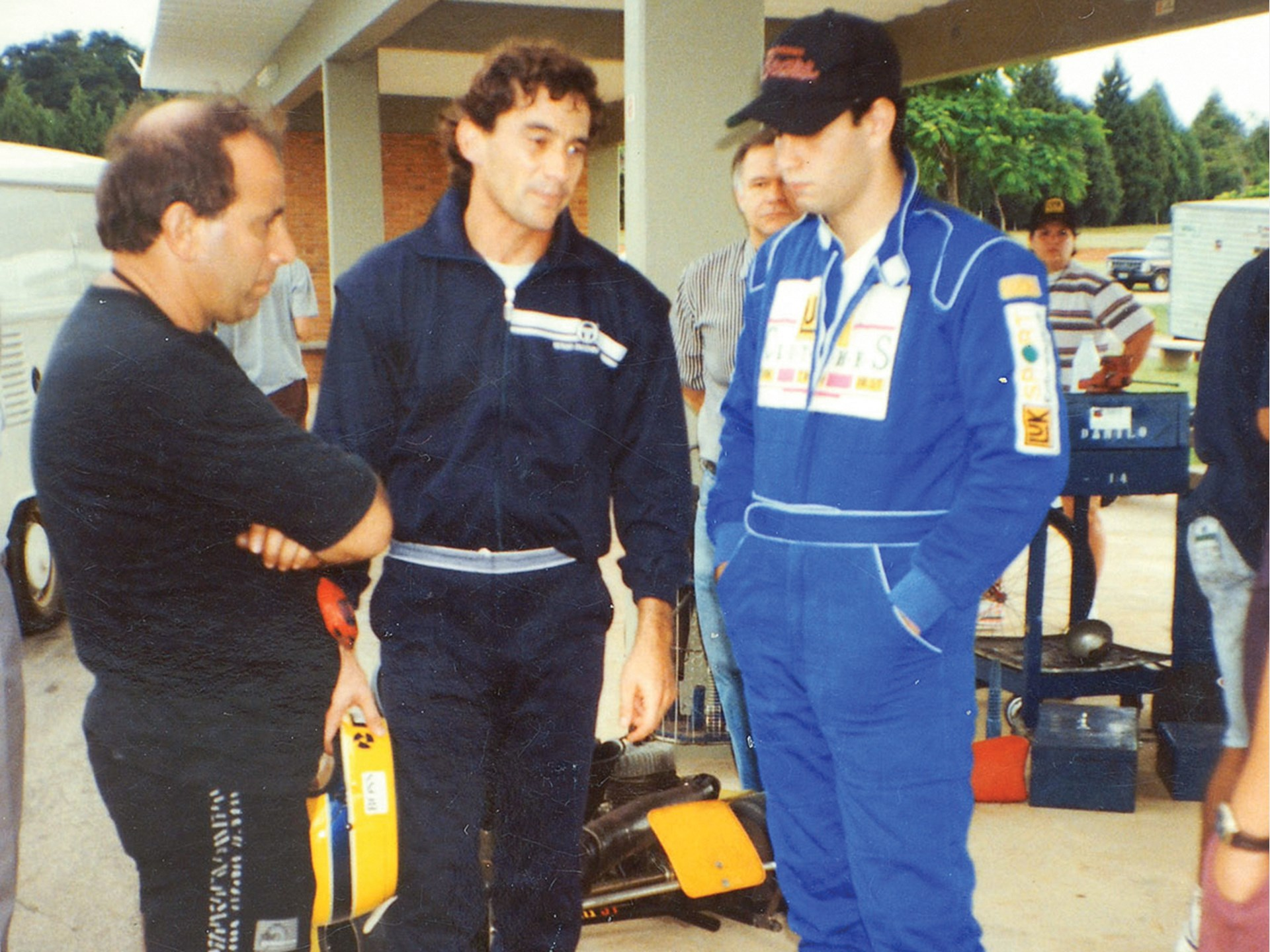 Senna with friends after driving the kart on his track.