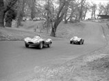 1955 Jaguar D-Type  - $Peter Blond in XKD 518 stays ahead of the Alfa Romeo 6C 3000 CM at the British Empire Trophy Meeting, Oulton Park, 14 April 1956.