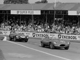 1955 Jaguar D-Type  - $Sporting #12, XKD 518, driven by Jonathan Sieff and Maurice Charles, leads the #6 D-Type of Duncan Hamilton and Peter Blond at the Goodwood Tourist Trophy, 13 September 1958.