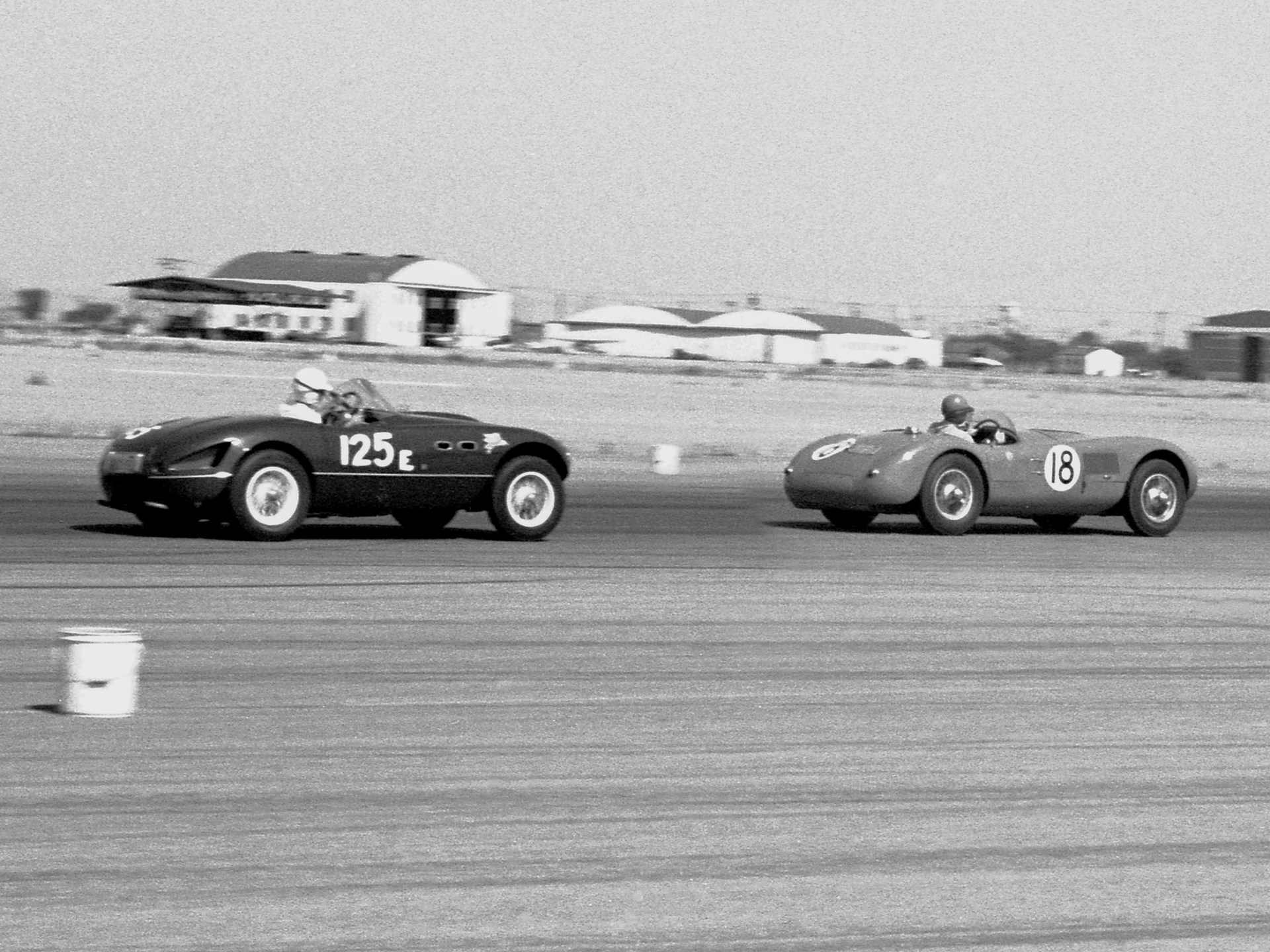 The Vignale-bodied Ferrari 166 (0342 M) piloted by Bill Louden chasing XKC 007 at Bakersfield in May of 1956.